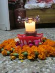 Rangoli with candle diya